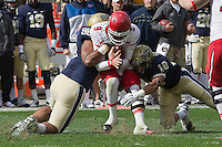 Justin Hargrove (96) and Jarred Holley (18) tackle Utah quarterback Jon Hays. The Utah Utes defeated the Pitt Panthers 26-14 at Heinz Field, Pittsburgh, Pennsylvania on October 15, 2011.