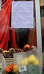 """NEWTOWN, CT - 16 December 2012-121612EC07--    Tributes to the victims and survivors of Friday's tragedy have sprung up across Newtown.  This handwrittten was taped up to the window outside a downtown retail shop.  The letter reminds people, """"If there's anything we can learn from the shooting at Sandy Hook Elementary is that we ALL need to slow down, simplify our lives, and take the time to appreciate our loved ones each and every moment.  Life is short, fragile.  If you don't do it now, you may not get another chance.""""  Erin Covey Republican-American."""