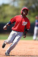 Washington Nationals infielder Khayyan Norfork (15) during a minor league spring training game against the Atlanta Braves on March 26, 2014 at Wide World of Sports in Orlando, Florida.  (Mike Janes/Four Seam Images)