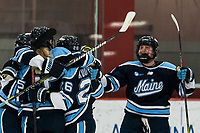 BOSTON, MA - JANUARY 04: Goal celebration. Ida Press #15 of University of Maine celebrates her goal with teammates during a game between University of Maine and Boston University at Walter Brown Arena on January 04, 2020 in Boston, Massachusetts.