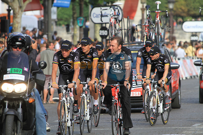 Johan Bruyneel team manager and Lance Armstrong (USA) and Team Radioshack part of the team parade at the end of the final Stage 20 of the 2010 Tour de France running 102.5km from Longjumeau to Paris Champs-Elysees, France. 25th July 2010.<br /> (Photo by Eoin Clarke/NEWSFILE).<br /> All photos usage must carry mandatory copyright credit (© NEWSFILE | Eoin Clarke)