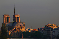Paris Right Bank: A view from faraway of the back of the church of Notre Dame in Paris, with the façades of some typical buildings, in the sunrise light.<br /> <br /> You can download this file for (E&PU) only, but you can find in the collection the same one available instead for (Adv).