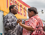 BATON ROUGE, LA -JULY 09:  While tempers flair at a protest at the Trip S Food Mart where Alton Sterling was shot and killed by Baton Rouge police four days ago, a couple stand off by themselves and prays in Baton Rouge, Louisiana July 9, 2016.  (Photo by Mark Wallheiser/Getty Images)
