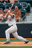 Third baseman Garrett Buechele #38  of the Oklahoma Sooners singles against the Texas Longhorns in NCAA Big XII baseball on May 1, 2011 at Disch Falk Field in Austin, Texas. (Photo by Andrew Woolley / Four Seam Images)