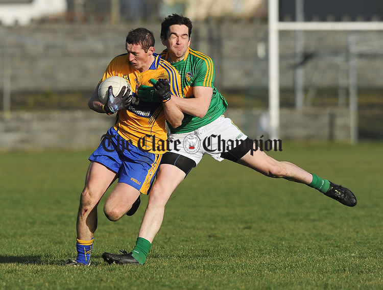 Cathal O Connor of Clare in action against Darren Sweeney of Leitrim during their Round 2 Division 4 national Football League game at Miltown Malbay. Photograph by John Kelly.