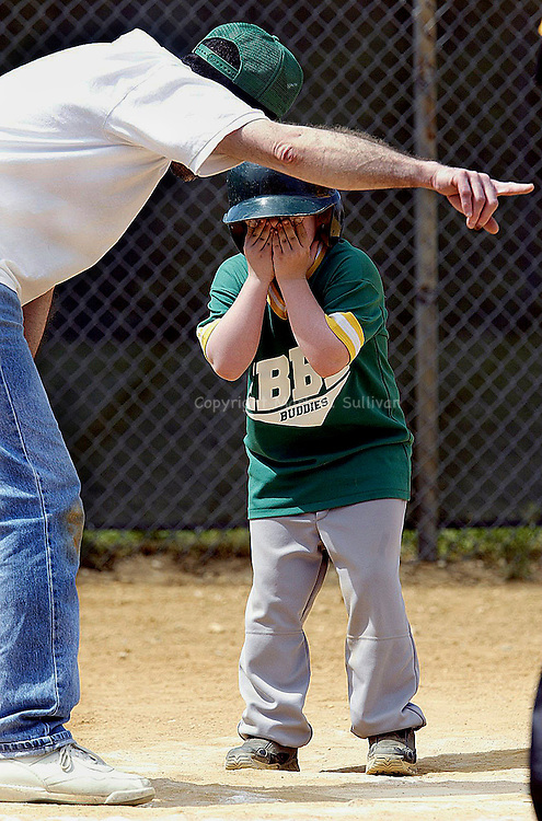 """""""IT'S ALRIGHT""""..The East Brunswick Baseball League held it's annual Buddy Ball Baseball games at Manager's Field in East Brunswick. Teams made up of volunteers & disabled children get together for a day of great baseball. Here coach Rich Quinn tries to explain to 8 yr old Travis Price of Somerset that he needs to run to 1st base after hitting a single during the game. Don't worry everything worked out and Travis  composed himself and made it to 1st base.(MARK R. SULLIVAN)"""