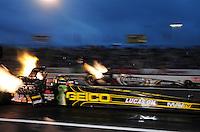 Jun. 1, 2012; Englishtown, NJ, USA: NHRA top fuel dragster driver Morgan Lucas (near lane) races alongside Shawn Langdon during qualifying for the Supernationals at Raceway Park. Mandatory Credit: Mark J. Rebilas-