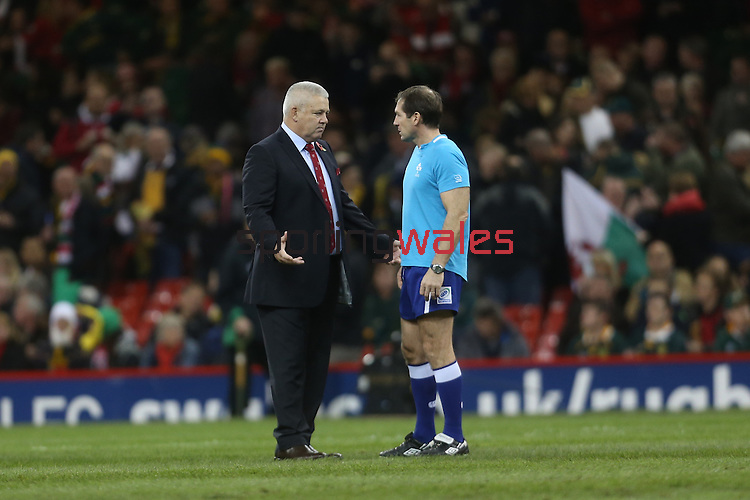 Wales coach Warren Gatland in discussion with referee Alain Rolland before kick off.<br /> <br /> 2013 Dove Men Series<br /> Wales v South Africa<br /> Millennium Stadium<br /> 09.11.13<br /> ©Steve Pope-Sportingwales