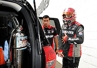 Jun. 2, 2012; Englishtown, NJ, USA: A crew member assists NHRA funny car driver Cruz Pedregon during qualifying for the Supernationals at Raceway Park. Mandatory Credit: Mark J. Rebilas-