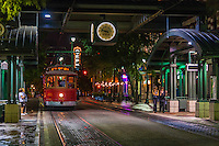 Urban Street of Memphis Tennessee, Street Photograph of a fast trolley train in downtown Memphis.<br /> The city is located on the confluence of the Wolf and Mississippi rivers. Downtown Memphis and metro area spread out through suburbanization, and encompass southwest Tennessee, northern Mississippi and eastern Arkansas. Several large parks were founded in the city in the early 20th century