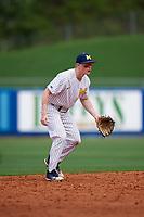 Michigan Wolverines shortstop Jack Blomgren (18) during a game against Army West Point on February 18, 2018 at Tradition Field in St. Lucie, Florida.  Michigan defeated Army 7-3.  (Mike Janes/Four Seam Images)