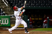 Aaron Luna (10) of the Springfield Cardinals hits a ball past the infield during a game against the Frisco RoughRiders on April 14, 2011 at Hammons Field in Springfield, Missouri.  Photo By David Welker/Four Seam Images.