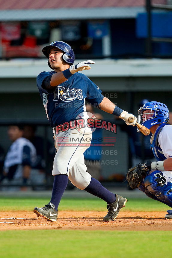 David Garcia (24) of the Princeton Rays follows through on a solo home run in the 6th inning against the Burlington Royals at Burlington Athletic Park on July 5, 2013 in Burlington, North Carolina.  The Royals defeated the Rays 5-1 in game one of a doubleheader.  (Brian Westerholt/Four Seam Images)