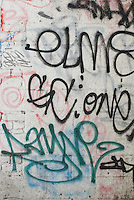 Wall in New York City's Chinatown with layers of Graffiti