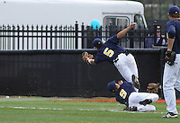Anthony Toth #5  of the University of Michigan Wolverines making a great catch against the Coastal Carolina University Chanticleers at the Carvelle Resort Classic Tournament held at Watson Stadium at Vrooman Field in Conway, SC on March 13, 2010. Photo by Robert Gurganus/Four Seam Images