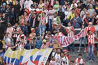 BOGOTA - COLOMBIA -05 -06-2016: Hinchas de Junior animan a su equipo durante partido de vuelta entre Millonarios y Atlético Junior por los cuadrangulares finales de la Liga Aguila I 2016 jugado en el estadio Nemesio Camacho El Campin de la ciudad de Bogota./ Fans of Junior cheer for their team during the second leg match between Millonarios and Atletico Junior for the finals quadrangular of the Liga Aguila I 2016 played at the Nemesio Camacho El Campin Stadium in Bogota city. Photo: VizzorImage / Gabriel Aponte / Staff.