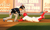 Reading Phillies outfielder Leandro Castro #18 is tagged out by Jonathan Diaz #3 during a game against the New Hampshire Fisher Cats at FirstEnergy Stadium on April 10, 2012 in Reading, Pennsylvania.  New Hampshire defeated Reading 3-2.  (Mike Janes/Four Seam Images)