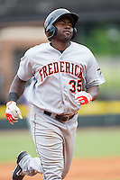 Michael Burgess (35) of the Frederick Keys rounds the bases after hitting a home run against the Winston-Salem Dash at BB&T Ballpark on May 18, 2014 in Winston-Salem, North Carolina.  The Dash defeated the Keys 7-6.  (Brian Westerholt/Four Seam Images)