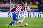 Alvaro Odriozola Arzallus (R) of Real Sociedad battles for the ball with Filipe Luis (L) of Atletico de Madrid during their La Liga match between Atletico de Madrid vs Real Sociedad at the Vicente Calderon Stadium on 04 April 2017 in Madrid, Spain. Photo by Diego Gonzalez Souto / Power Sport Images