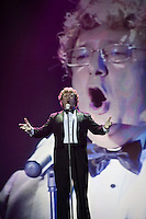 """Moscow, Russia, 25/09/2010..Russian competitor gastroenterologist Doctor Fedor Rytikov performs Puccini's aria """"Nessun Dorma"""" in the finals of the Karaoke World Championships 2010, where amateur singers from around the world competed for prizes that included one million Russian dumplings."""