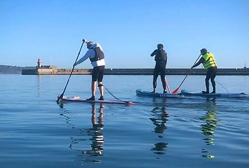 Paddleboarders doing their bit