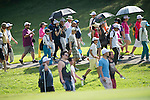 Spectators follow golfers at UBS Hong Kong Open golf tournament at the Fanling golf course on 25 October 2015 in Hong Kong, China. Photo by Aitor Alcalde / Power Sport Images