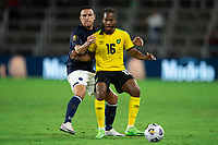 ORLANDO, FL - JULY 20: Daniel Johnson #16 of Jamaica dribble the ball during a game between Costa Rica and Jamaica at Exploria Stadium on July 20, 2021 in Orlando, Florida.