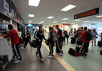 Wednesday 28 August 2013<br /> Pictured: Players and staff queuing at the baggage check in counters in Cardiff Airport.<br /> Re: Swansea City FC players and staff en route for their UEFA Europa League, play off round, 2nd leg, against Petrolul Ploiesti in Romania.