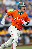 Miami Hurricanes catcher Zack Collins (0) runs to first base after hitting a first inning home run against the UC Santa Barbara Gauchos in Game 5 of the NCAA College World Series on June 20, 2016 at TD Ameritrade Park in Omaha, Nebraska. UC Santa Barbara defeated Miami  5-3. (Andrew Woolley/Four Seam Images)