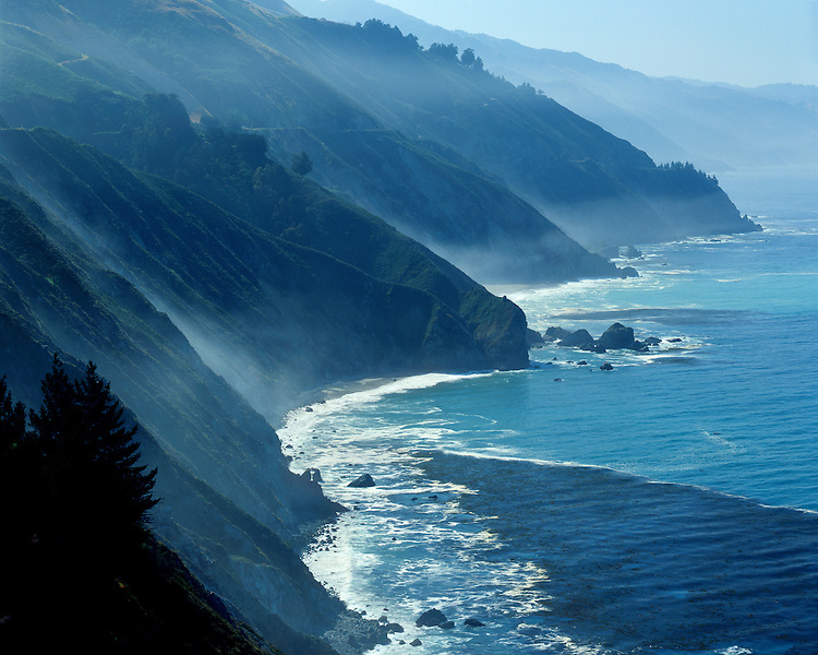 Foggy Morning light on cliffs along the Pacific Ocean at Big Sur on Highway 1, CA
