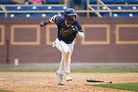 TJ Ash (13) of the North Carolina A&T Aggies hustles down the first base line against the North Carolina Central Eagles at Durham Athletic Park on April 10, 2021 in Durham, North Carolina. (Brian Westerholt/Four Seam Images)