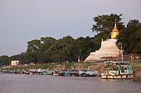 Myanmar, Burma.  Buddhist Stupa and Local Boats on Ayeyarwady (Irrawaddy) River Bank.