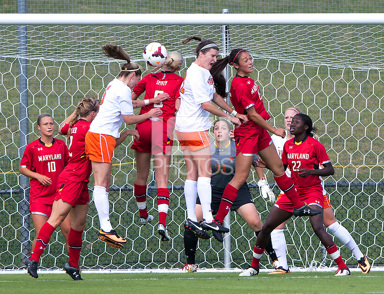 Morgan Brian (6)  and Annie Steinlage (10) of Virginia go up for a header in the box with Ashley Spivey (8) and Erika Nelson (15) of Maryland during the game at Klockner Stadium in Charlottesville, VA.  Virginia defeated Maryland, 1-0.