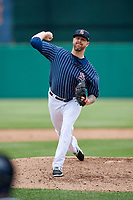 Syracuse Chiefs relief pitcher Justin Miller (15) delivers a pitch during a game against the Lehigh Valley IronPigs on May 20, 2018 at NBT Bank Stadium in Syracuse, New York.  Lehigh Valley defeated Syracuse 5-2.  (Mike Janes/Four Seam Images)