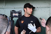 First baseman Christian Walker (23) of the Delmarva Shorebirds talks with the media a game against the Greenville Drive on  Friday, April 26, 2013, at Fluor Field at the West End in Greenville, South Carolina. Walker played for the National Champion University of South Carolina Gamecocks. He is listed as the No. 12 prospect of the Baltimore Orioles, according to Baseball America. He was a fourth-round draft pick in 2012. (Tom Priddy/Four Seam Images)