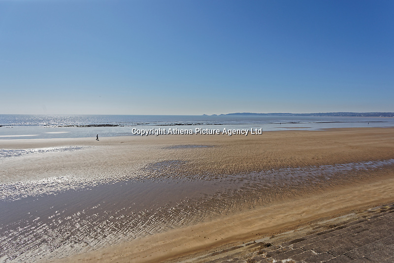 Pictured: The almost deserted beach overlooking Mumbles in Swansea, Wales, UK. Thursday 26 March 2020<br /> Re: Covid-19 Coronavirus pandemic, UK.