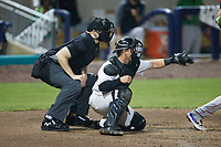 Kannapolis Cannon Ballers catcher Daniel Millwee (13) frames a pitch as home plate umpire Jacob McConnell looks on during the game against the Down East Wood Ducks at Atrium Health Ballpark on May 5, 2021 in Kannapolis, North Carolina. (Brian Westerholt/Four Seam Images)