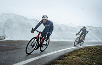 Vincenzo Nibali (ITA/Trek-Segafredo) & George Bennett (NZL/Jumbo-Visma) descending from the Passo Giau<br /> <br /> due to the bad weather conditions the stage was shortened (on the raceday) to 153km and the Passo Giau became this years Cima Coppi (highest point of the Giro).<br /> <br /> 104th Giro d'Italia 2021 (2.UWT)<br /> Stage 16 from Sacile to Cortina d'Ampezzo (shortened from 212km to 153km)<br /> <br /> ©kramon