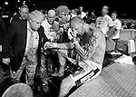 George Sullivan is attended to by a ringside doctor, left, and his manager Kurt Pellegrino, center, peers over to see the damage to his fighter's hand after Sullivan knocked out Jesus Martinez.