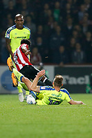 Andreas Weimann of Derby County goes to ground chasing Rico Henry of Brentford during the Sky Bet Championship match between Brentford and Derby County at Griffin Park, London, England on 26 September 2017. Photo by Carlton Myrie / PRiME Media Images.