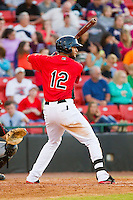 Nomar Mazara (12) of the Hickory Crawdads at bat against the Kannapolis Intimidators at L.P. Frans Stadium on May 25, 2013 in Hickory, North Carolina.  The Crawdads defeated the Intimidators 14-3.  (Brian Westerholt/Four Seam Images)