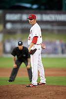 Auburn Doubledays relief pitcher David Smith (21) looks in for the sign during a game against the Lowell Spinners on July 13, 2018 at Falcon Park in Auburn, New York.  Lowell defeated Auburn 8-5.  (Mike Janes/Four Seam Images)