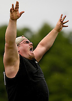 A competitor reacts after throwing the caber in the heavy Scottish Athletic Events during the 52nd Annual Grandfather Mountain Highland Games in Linville, NC.