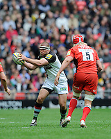 Rob Buchanan of Harlequins in action against Mouritz Botha of Saracens during the Aviva Premiership match between Saracens and Harlequins at Wembley Stadium on Saturday 31st March 2012 (Photo by Rob Munro)
