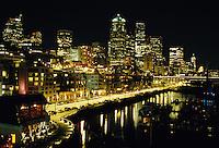 View of Seattle's waterfront skyline with night lighting. Seattle, Washington.