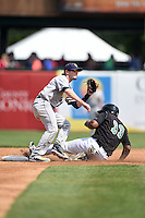 Burlington Bees second baseman Kody Eaves (21) waits for a throw as Jeffrey Baez (33) steals second during a game against the Kane County Cougars on August 20, 2014 at Third Bank Ballpark in Geneva, Illinois.  Kane County defeated Burlington 7-3.  (Mike Janes/Four Seam Images)
