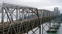 aerial photograph of a foot race across the San Francisco Oakland Bay Bridge on the old cantileavered span between Oakland and Treasure Island