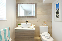 BNPS.co.uk (01202) 558833. <br /> Pic: KnightFrank/BNPS<br /> <br /> Pictured: Bathroom. <br /> <br /> The ultimate room with a view...<br /> <br /> A former fish cellar that is now an idyllic waterfront home overlooking a famous Cornish beach is on the market for £930,000.<br /> <br /> The ground floor apartment is in a prime frontline position with exceptional panoramic views over Porthmeor Beach and out to sea.<br /> <br /> Estate agent Christopher Bailey said the window in the reception space is like having your own live television screen looking out on the action of the beach.<br /> <br /> It has been designed and renovated to an exceptionally high standard and the immaculate flat is currently rented out for short holiday let, making about £40,000 profit a year.