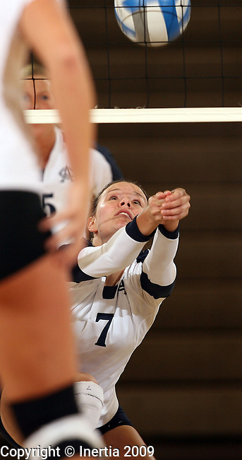 SIOUX FALLS, SD - SEPTEMBER 29:  Dani Haley #7 of Augustana digs the ball in the first game of their match against St. Cloud State University Tuesday night at the Elmen Center. (Photo by Dave Eggen/Inertia).