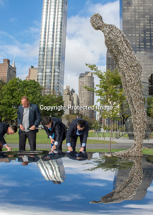 """Presentation of Gift entitled """"Consciousness"""" from Mongolia to the United Nations<br /> <br /> Cleaning the Sculpture <br /> <br /> Former President Tsakhiagiin Elbegdorj, and the Artist of the art sculpture"""